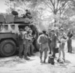Operation Askari - Soldiers standing next to a Ratel - SANDF Documentation Centre